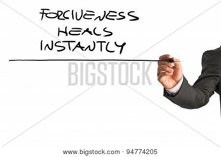 Professional Therapist Writing A Forgiveness Heals Instantly Saying