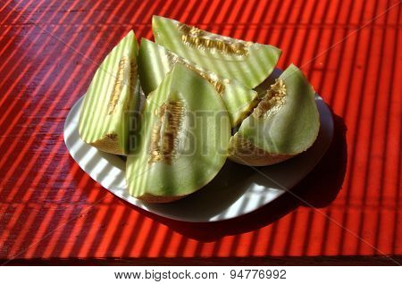 Cubist striped effect of jalousie on spanish sugar melon slices