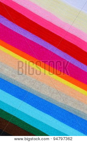 Background from multicolor wool felt cloth sheets poster