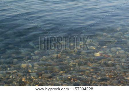 Clear as crystal water of Lake Baikal. Summer. Lake Baikal, Russia