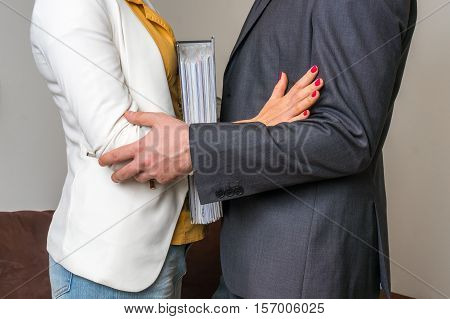 Man Touching Woman's Elbow - Sexual Harassment In Office