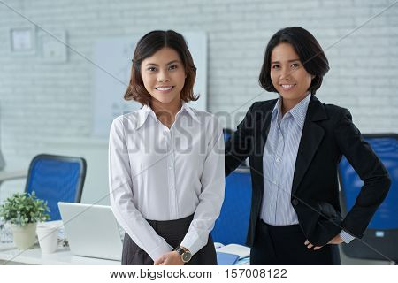 Portrait of happy experienced business lady and intern