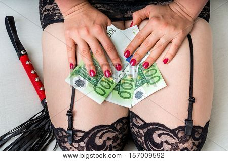 Prostitute On The Bed After Work With Euro Money