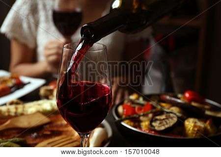 Delicious dinner with grilled vegetables and wine