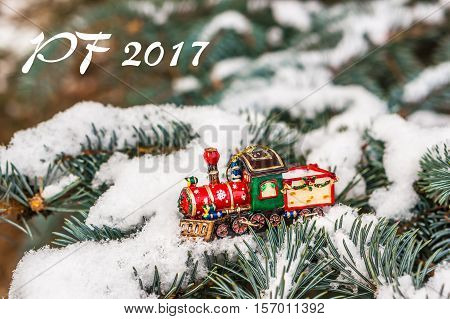 Pf 2017 - Red Christmas Toy Train On Snowy Branch Fir