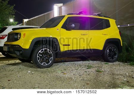 Sochi, Russia - October 09, 2016: New shining yellow Jeep Renegade on the street of Sochi City at night.