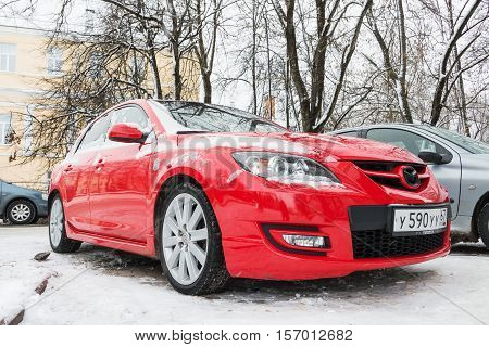 Smolensk, Russia - November 12, 2016: Mazda 3 (Axela) parked in winter street. Compact car manufactured in Japan by Mazda.