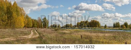 Panoramic photo of beautiful autumn country landscape