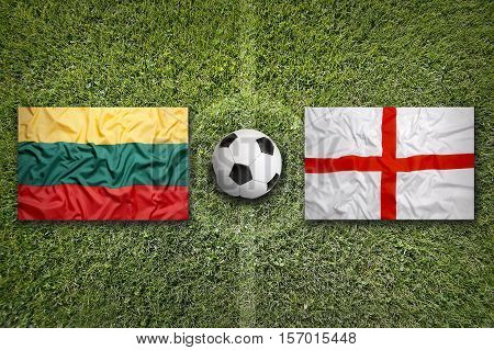 Lithuania vs. England flags on a green soccer field, 3d rendering