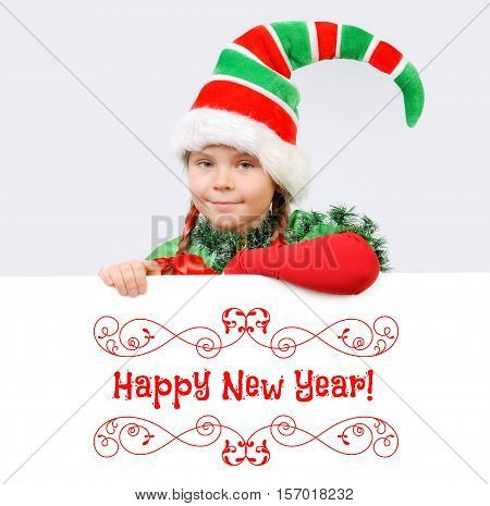 Girl in suit of Christmas elf with the white banner. Background for your Merry Christmas and Happy New Year projects.