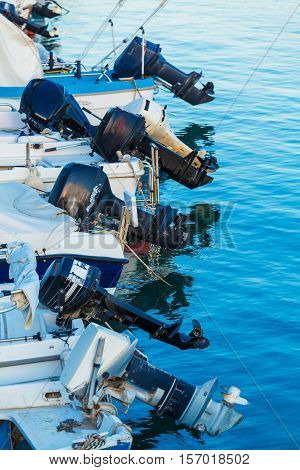 Modern Outboard engines on raw of fishing boats