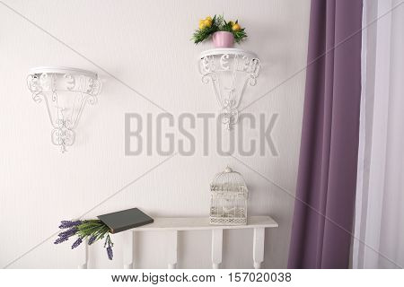 Book, flowers, bird cage, hanging planter for flowers in the room