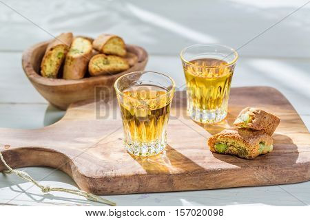 Delicious Cantucci With Wine On Old Wooden Table