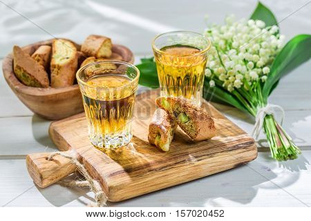 Delicious Biscotti With Wine On Old Wooden Table