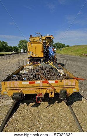 Railroad car trailer full of parts for repair and care of train tracks