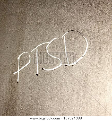 picture of a PTSD concept word on frosty window background