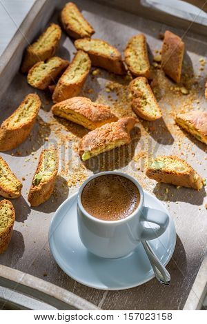 Crispy Cantucci With Coffee On Old Wooden Table