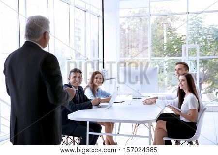 Business training concept. Colleagues at an office meeting