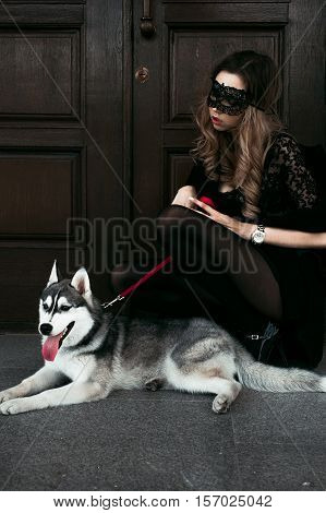 The Girl With The Siberian Husky. Delightful Girl Plays With A Siberian Husky. Girl Walking With A H