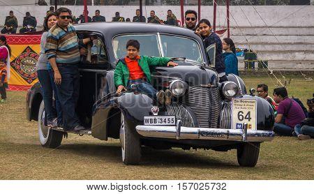 KOLKATA, INDIA - JANUARY 31, 2016: Indian family rides their Cadillac vintage car after flag off at the Statesman vintage car rally and roadshow in Kolkata.
