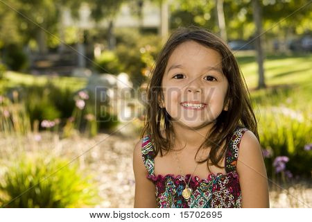 Cute little girl playing outside