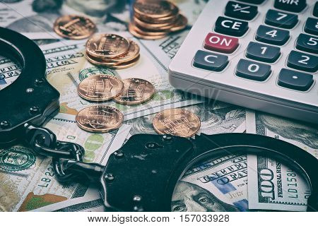Tax Offense Concept. Us Dollars And Handcuffs