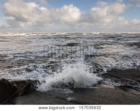 WHITBY ENGLAND - NOVEMBER 5: Rough sea crashing against rocks. In Whitby North Yorkshire England. On 5th November 2016.
