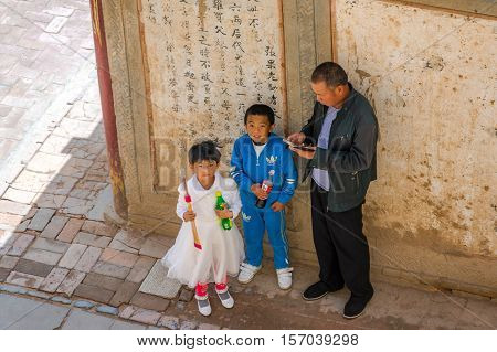 Family At Horse's Hoof Temple, Mati Si, China
