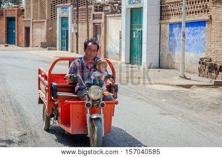 Man Driving With Kid In Motorbike Caravan