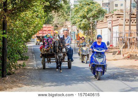 Donkey Carriage And Motorbikes, Turpan, China