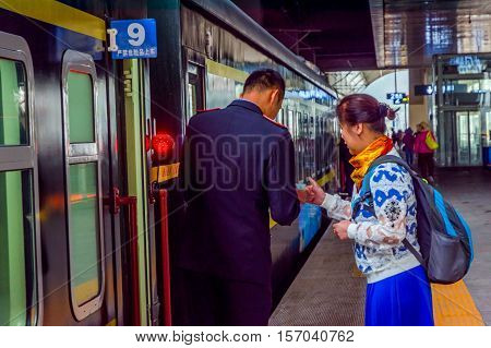 Conductor At Train Station, Xining, China