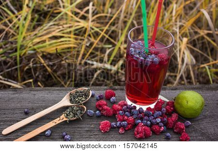 bubble tea with fresh pomegranate fruits on wooden table. Vitamins and minerals. Healthy drink concept.