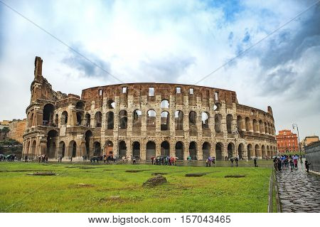 COLOSSEUM ROME ITALY - NOVEMBER 8 : tourist taking a photo in front of colosseum ancient site on november 8 2016 in rome italy