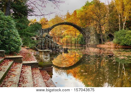 Rakotz Bridge (rakotzbrucke, Devil's Bridge) In Kromlau, Saxony, Germany. Colorful Autumn, Reflectio