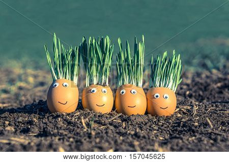 Happy egg family on the soil Easter - retro style