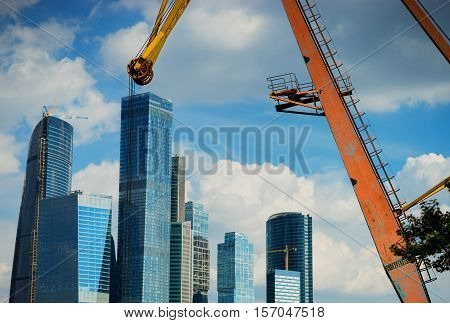 Moscow city business center on the back of old industrial crane background hd