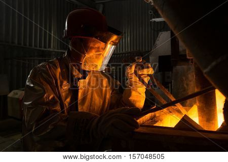 Siberia, Russia - NOVEMBER 14, 2016: moulting gold at a factory