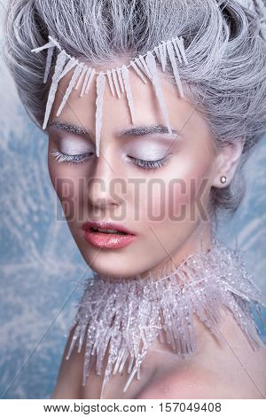 Snow Queen.Fantasy girl portrait. Winter fairy portrait.Young woman with creative silver artistic make-up. Winter Portrait.