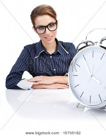 Portrait of responsible woman with watch in the office