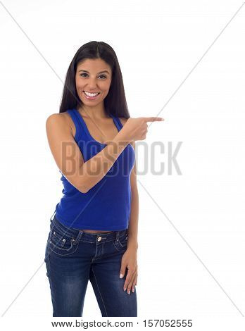 young attractive hispanic woman in casual top and jeans smiling happy and cheerful pointing with finger presenting isolated on white background in positive corporate portrait with copy space