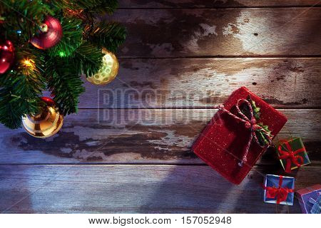 close up view of christmas tree toys and lights on wooden back