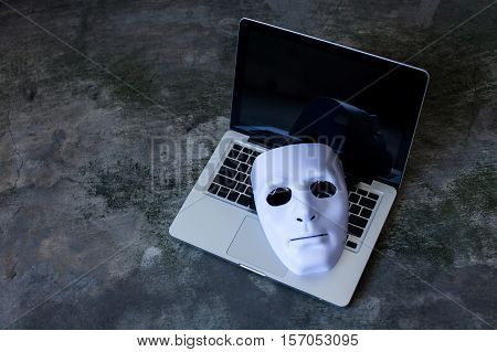 Anonymous Mask To Hide Identity On Computer Laptop - Internet Criminal And Cyber Security Threat Con