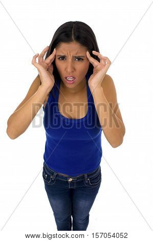 young attractive latin woman holding her head in stress suffering headache and migraine in health care concept isolated on white background