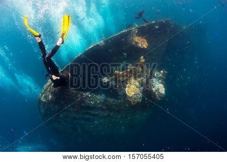 Free diver exploring the ship wreck in a tropical sea. Tulamben, Bali.