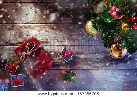 close up view of christmas tree and gifts on wooden back