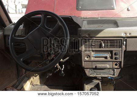 Broken down vintage taxi with open hood in Cuba