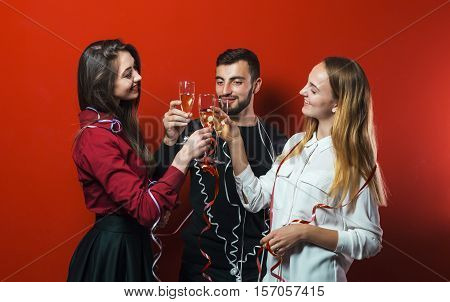 Friends on a New Year party have fun, friendly celebration
