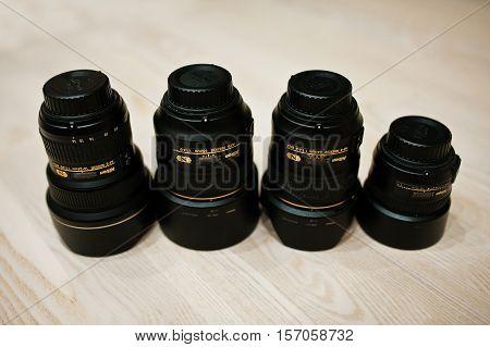 Hai, Ukraine -2 August 2016: Top Four Nikon Nikkor Lense On Wooden Background