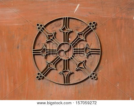 Dharma Wheel Buddhist Symbol In Old Door