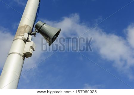 Loudspeaker on public post with copy space